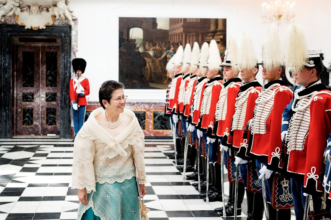 Ambassador Batoon-Garcia reviewing the Royal Danish Guards inside the Fredensborg Palace, Denmark, on her way to the audience with Her Majesty, Queen Margrethe II of Denmark.