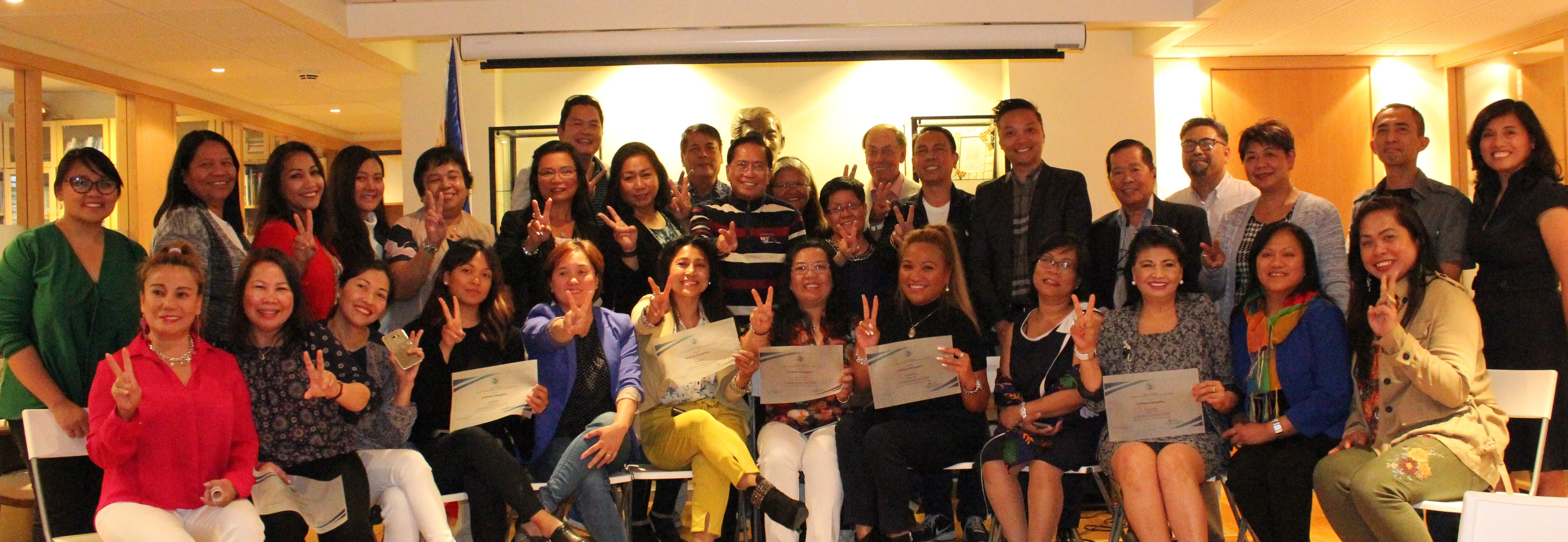 Philippine Ambassadors for Peace, Embassy officers and staff, and OPAPP Secretary Dureza (center)