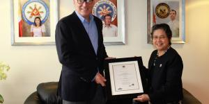 Ambassador Batoon-Garcia Presents the Signed Citation of the Order of Sikatuna, Grand Cross, with the Rank of Datu, to Former Norwegian Ambassador to the Philippines Erik Førner